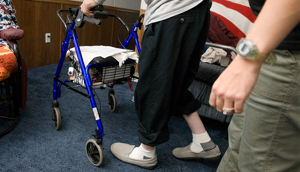 Elderly man using a walker.